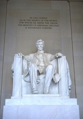 "Statue of Abraham Lincoln in the Lincoln Memorial with the inscription, ""In this temple as in the hearts of the people for whom he saved the union the memory of Abraham Lincoln is enshrined forever."""